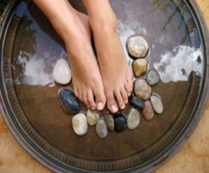 A photo for the Spa Retreat package showing a relaxing foot soak.