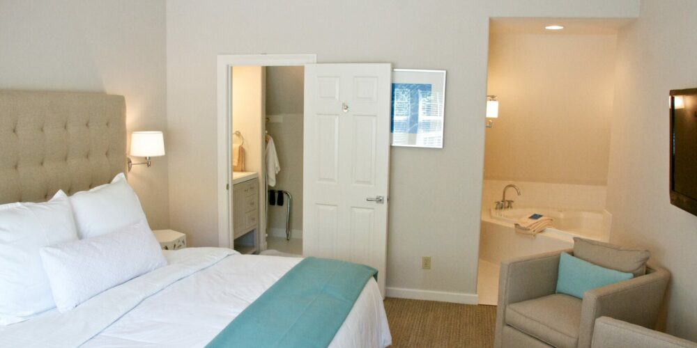 This room is located on the second floor of our main building overlooking the garden courtyard. The room features a pillow top King bed, one-person sized mineral spring soaking tub, and more. View Details